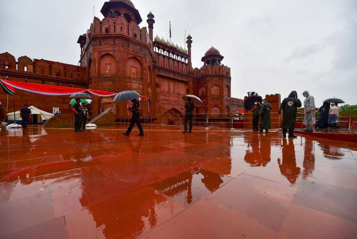 India Tv - New Delhi: Security personnel during the full dress rehearsals for the 74th Independence Day celebrations, amid the ongoing COVID-19 pandemic, on a rainy day at Red Fort in New Delhi, Thursday, Aug. 13, 2020.