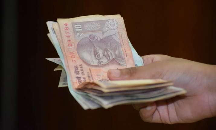 Rupee settles flat at 74.94 against USD after RBI keeps rates on hold