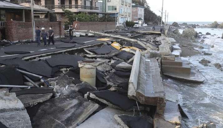 A coastal road is damaged in Ulsan, South Korea, Monday, Sept. 7, 2020. A powerful typhoon damaged b