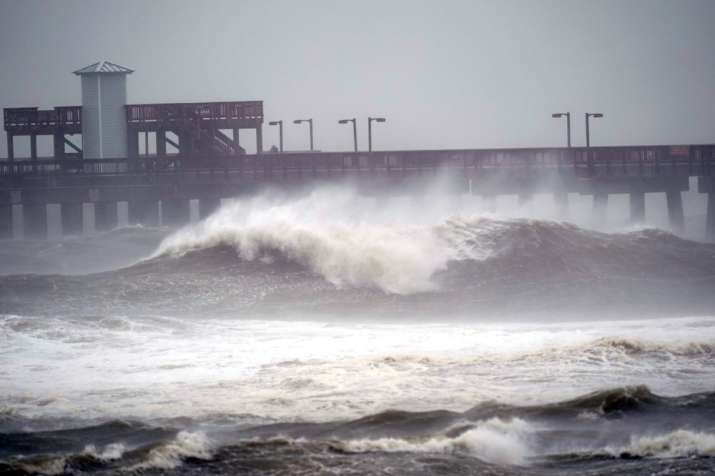 Waves crash near a pier, at Gulf State Park, Tuesday, Sept. 15, 2020, in Gulf Shores, Ala. Hurricane