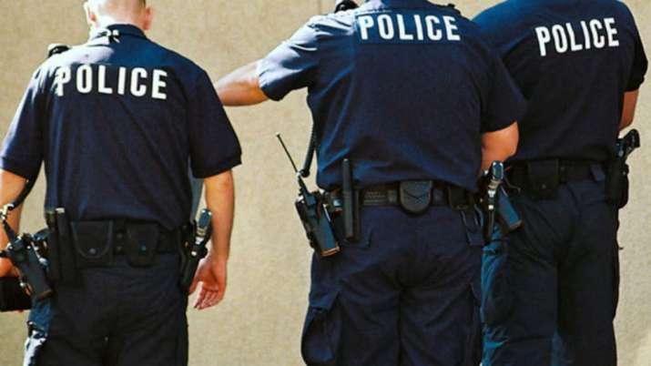 2 US policemen shot during protest, suspect held