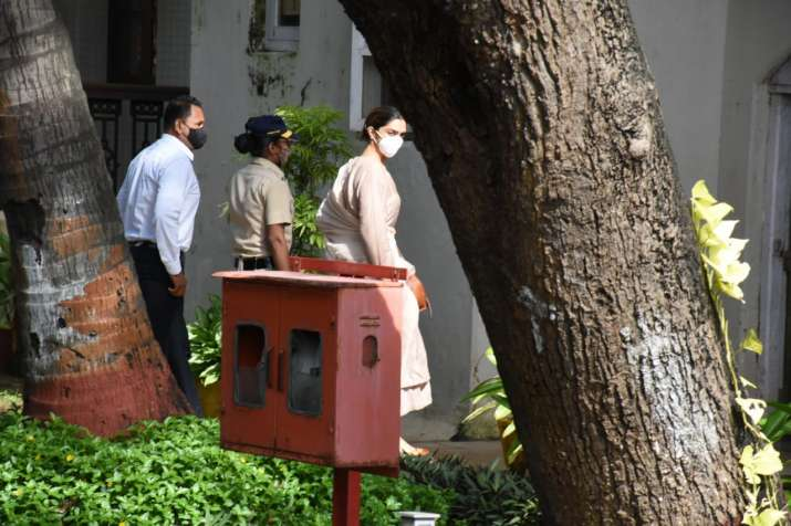 India Tv - The actress giving a glance at the reporters present there before she enters the NCB guest house