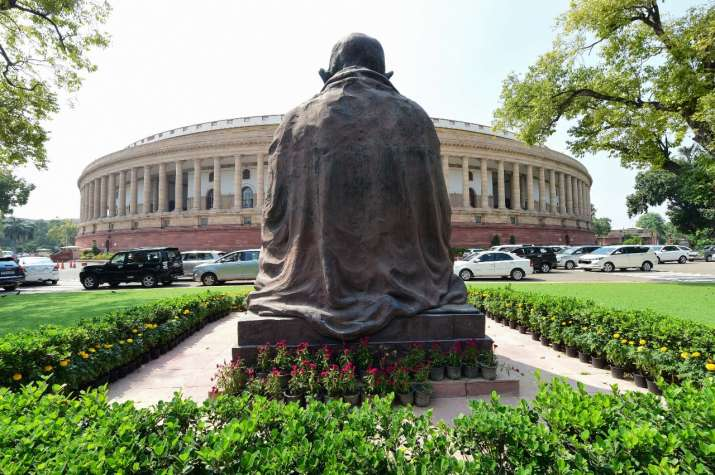 Opposition members sit in protest against farm bill inside Rajya Sabha