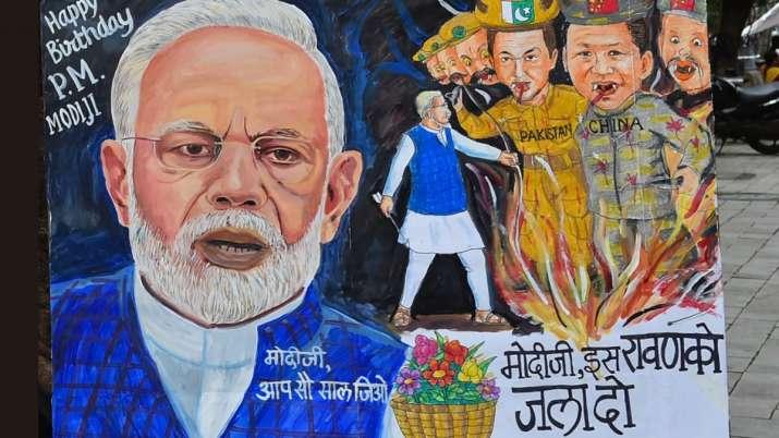 Mumbai: An artist makes a painting for Prime Minister Narendra Modi's 70th Birthday. PM Modi turns 7