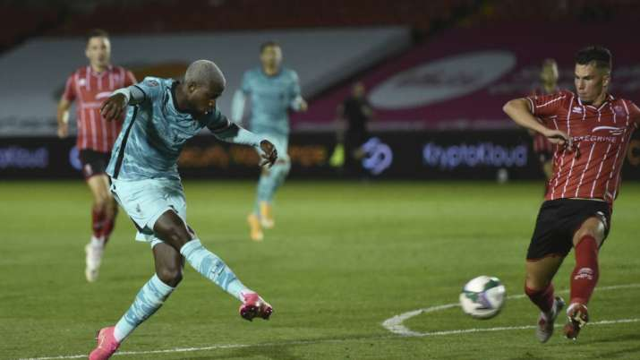Liverpool's Divock Origi, left, shoots and scores his sides