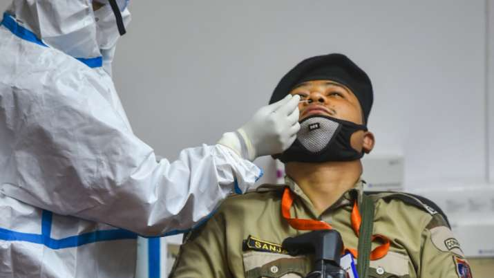 Health workers conduct COVID-19 testing of security personnel, at Vidhan Sabha in New Delhi, Monday,