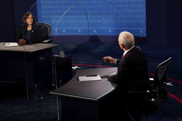 Democratic vice presidential candidate Sen. Kamala Harris, D-Calif., listens as Vice President Mike
