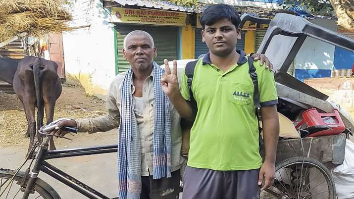 Arvind Kumar, who has secured All India rank 11603 and 4392 in OBC category, with his father Bhikhar