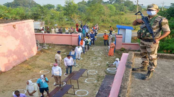 India Tv - Kaimur: Voters, adhering to social distancing norms, stand in a queue to cast their votes for the fi
