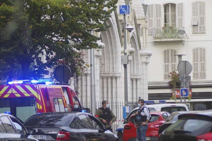 French policemen stand next to Notre Dame church after a knife attack, in Nice, France