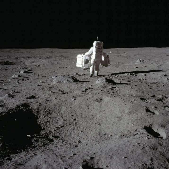 In this July 20, 1969 photo made available by NASA, lunar module pilot Buzz Aldrin carries a seismic