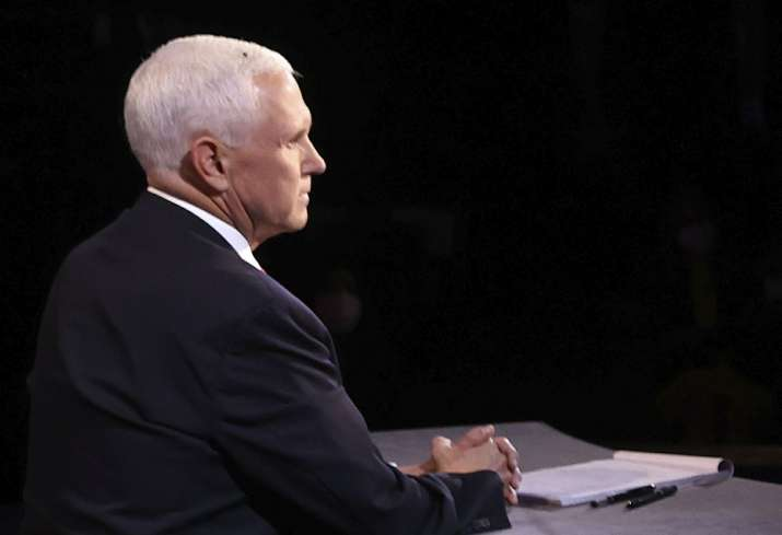 A fly lands on the head of Vice President Mike Pence during the vice presidential debate at Kingsbur