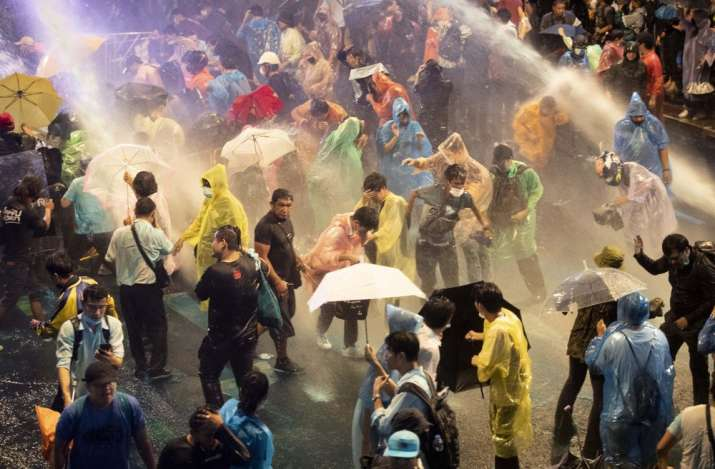 Thailand: Police use water cannon against protesters in Bangkok as PM refuses to quit
