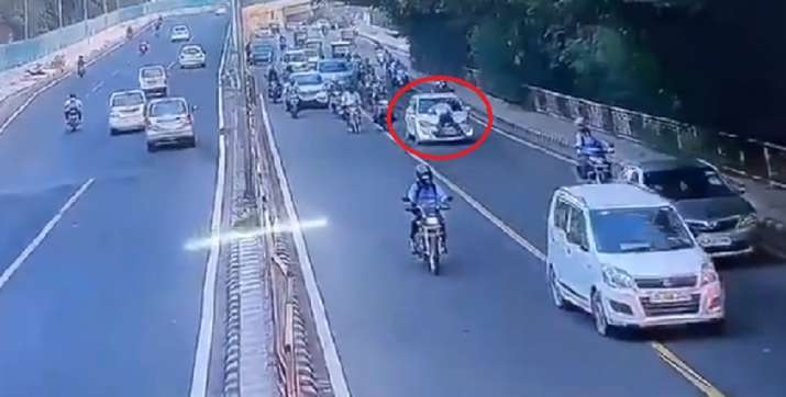 Delhi cop dragged, dhaula kuan, delhi cop dragged on car bonnet, delhi traffic police cop, dhaula ku