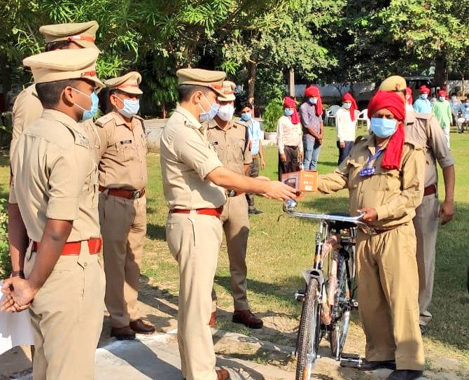 India Tv - The police officials gave cycles and torches to village guards