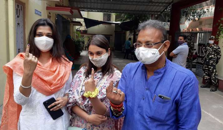 India Tv - JD-U Working State President Ashok Chaudhary and his family members show their finger marked with indelible ink after casting votes during the second phase of Bihar assembly polls, amid the ongoing coronavirus pandemic, in Patna.