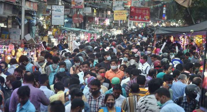 Shoppers visit a crowded Chandni Chowk market during