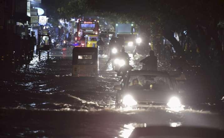 India Tv -  Chennai: Vehicles ply on a waterlogged road during heavy rain triggered by Cyclone Nivar, in Chennai, Tuesday, Nov. 24, 2020.