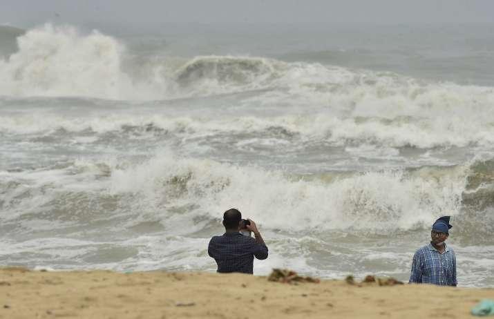 Chennai: A man clicks photographs as turbulent waves crash