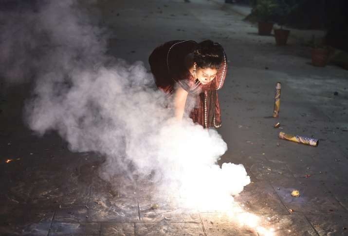 India Tv - People burst fire crackers during Diwali celebrations in Ghaziabad, Saturday, Nov. 14, 2020. Due to rising air pollution and risk of spike in Covid infections, various states and Union Territories across the country have either imposed a complete ban on fire crackers on Diwali or permitted them with heavy restrictions.