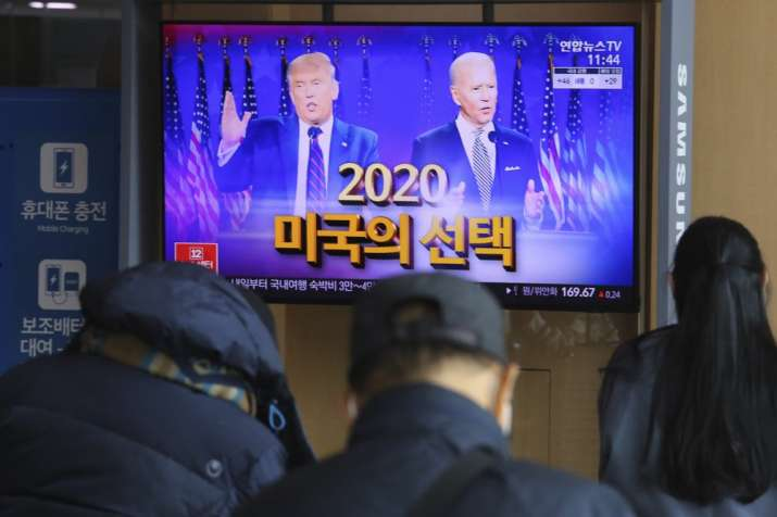 A TV screen shows images of U.S. President Donald Trump, left, and Democratic presidential candidate