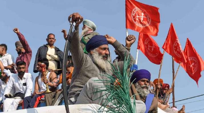 New Delhi: Farmers protest at Singhu border during their