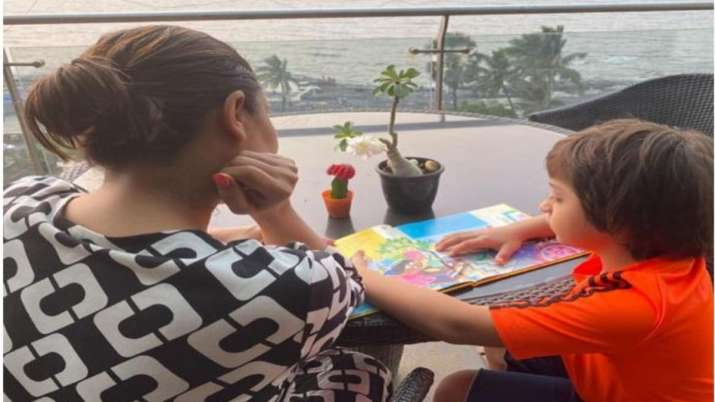 Mom Gauri Khan shares a glimpse of AbRam reading Karan Johar's book, says 'all grown up'