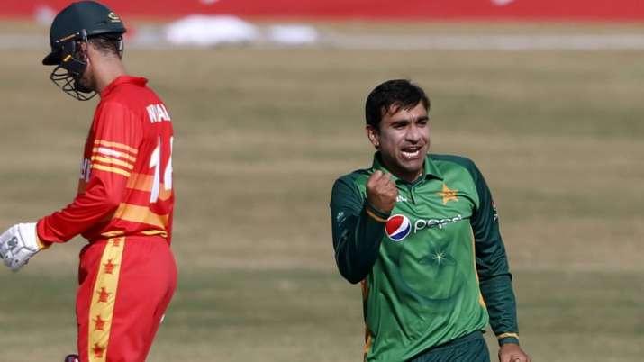 Pakistani spinner Iftikhar Ahmed, right, celebrates after