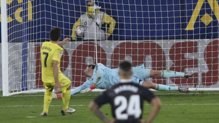 Villareal's Gerard Moreno, left, scores the penalty kick