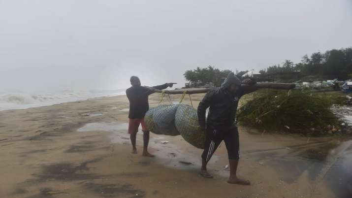 Fishermen move towards a safer place from a coastal area, as Cyclone Nivar is expected to make landf