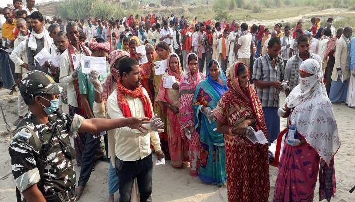 India Tv - Voters stand in queues to cast their votes during the second phase of Bihar assembly elections, amid the ongoing coronavirus pandemic, in Patna