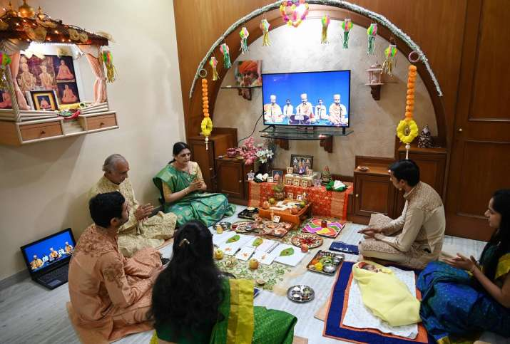 India Tv - Kiran Shah, a businessma, along with his family performs rituals during Chopda Pujan (the worshipping of account books) at home on the occasion of Diwali, as temples are closed due to the COVID-19 pandemic, in Mumbai