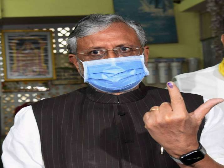 India Tv - Bihar Deputy CM Sushil Kumar Modi shows his finger marked with indelible ink after casting vote during the second phase of Bihar assembly polls, in Patna