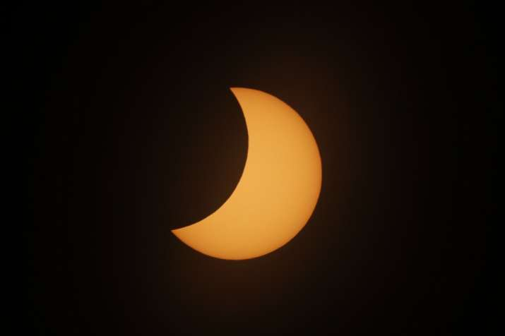 India Tv - The moon covers the sun during a total solar eclipse in Piedra del Aguila, Argentina, Monday, Dec. 14, 2020. The total solar eclipse was visible from the northern Patagonia region of Argentina and from Araucania in Chile, and as a partial eclipse from the lower two-thirds of South America.