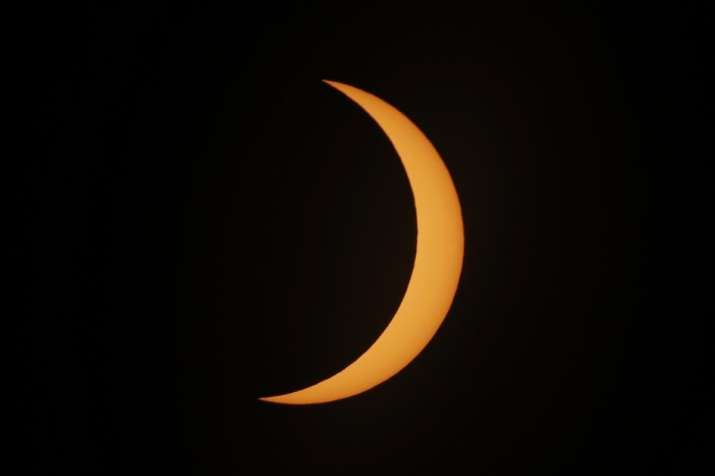 India Tv - The moon moves across the the sun during a solar eclipse in the path of totality in Piedra del Aguila, Argentina, Monday, Dec. 14, 2020. The total solar eclipse was visible from the northern Patagonia region of Argentina and from Araucania in Chile.