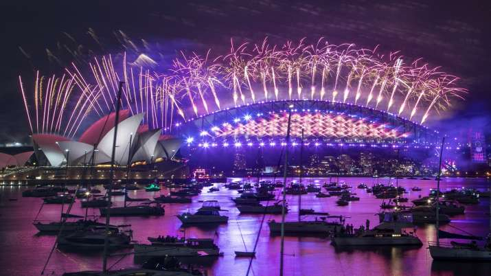 Fireworks explode over the Sydney Opera House and Harbour