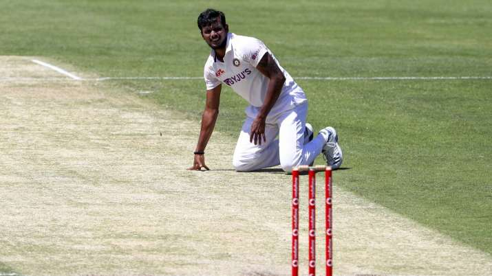 India's Thangarasu Natarajan falls onto the pitch during