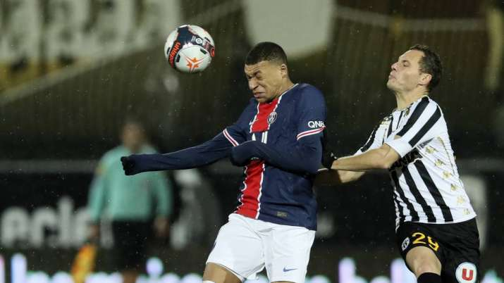 PSG's Kylian Mbappe, left, duels for the ball with Angers'