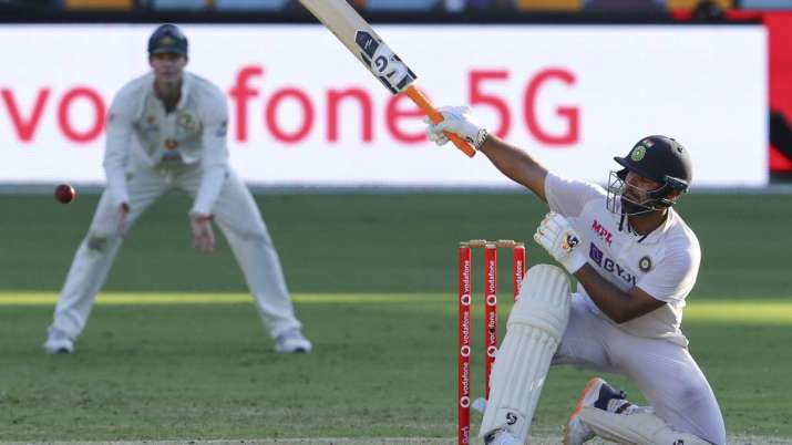 India's Rishabh Pant hits the ball to the boundary on the