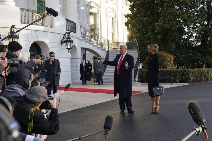 India Tv - President Donald Trump and first lady Melania Trump stop to talk with the media as they walk to board Marine One on the South Lawn of the White House, Wednesday, Jan. 20, 2021, in Washington. Trump is en route to his Mar-a-Lago Florida Resort. (AP Photo/Alex Brandon)
