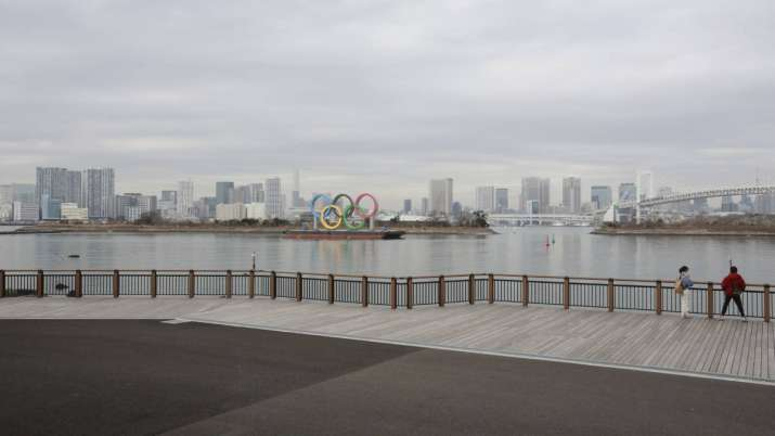 The Olympic rings are seen at the empty Odaiba waterfront