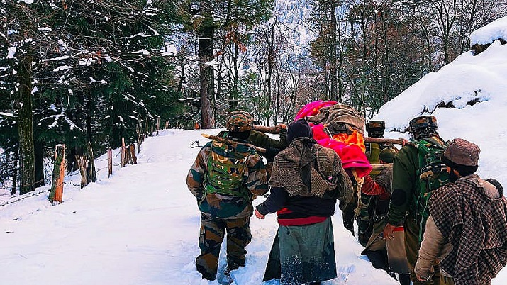 J&K: Army jawans wade through knee-deep snow to carry pregnant woman to hospital