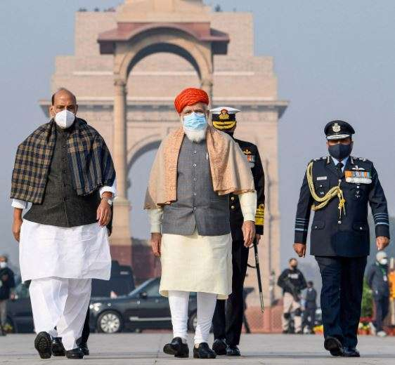 India Tv - Prime Minister Narendra Modi and Defence Minister Rajnath Singh arrive at the National War Memorial, on the occasion of the 72nd Republic Day Parade 2021, in New Delhi, Tuesday, Jan. 26, 2021.