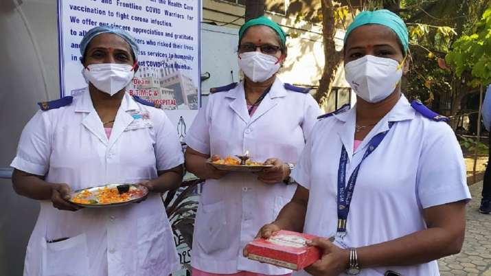 With 'arti' thalis and sweets health workers at Mumbai hospital cheer as vaccines arrive
