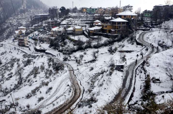 India Tv - McLeodganj: View of the snow-covered Naddi village after a fresh snowfall, near McLeodganj in Himachal Pradesh, Monday, Dec. 28, 2020.