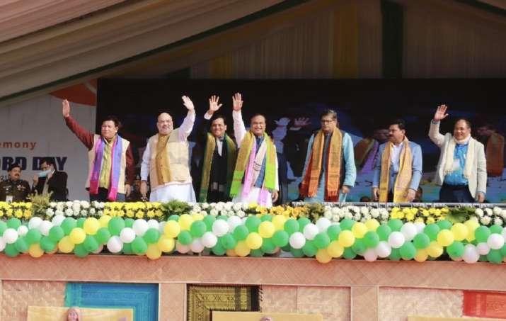 Amit shah assam rally, amit shah in assam, aiudf, congress, assam rally, amit shah assam, infiltrato