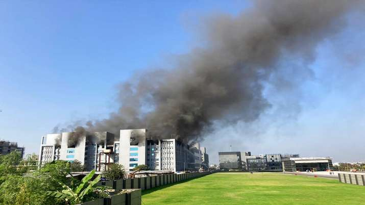 Smoke rises from the Serum Institute of India, the world's