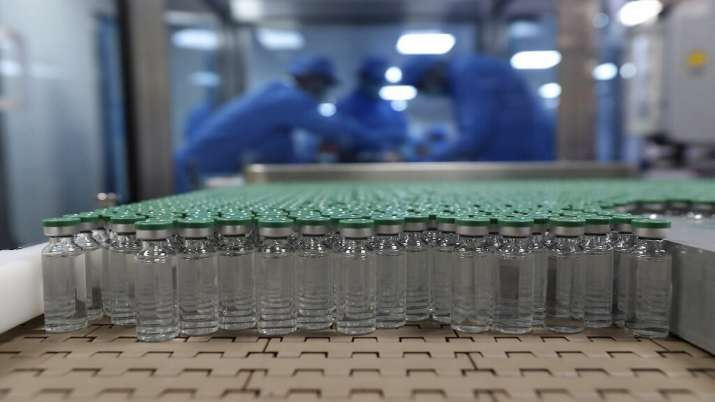 Vials of COVID-19 vaccine are seen before they are packed
