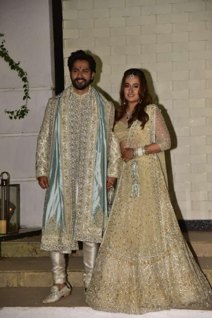 India Tv - Varun & Natasha post wedding greeted the paparazzi waiting outside the venue