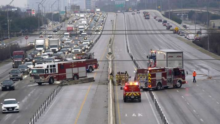 The highway sits closed as emergency crews finish cleaning